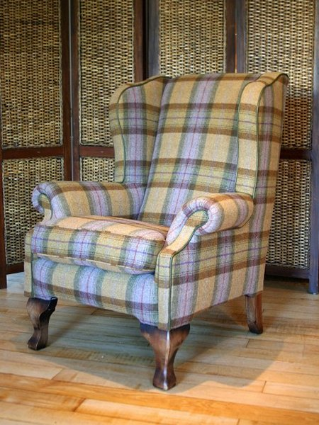 The Contrast Upholstery Chaucer Chair shown here in Blackberry Crumble Yorkshire Wool fabric by Tetrad