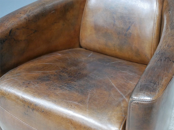 Brazilian Brown Leather Cigar Chair - Close up image showing the vintage brown leather finish