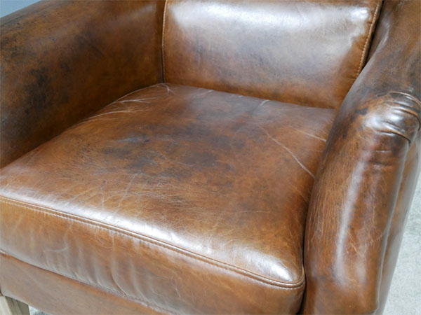 Brazilian Brown Leather Reading Chair - Close up image showing the vintage brown leather finish
