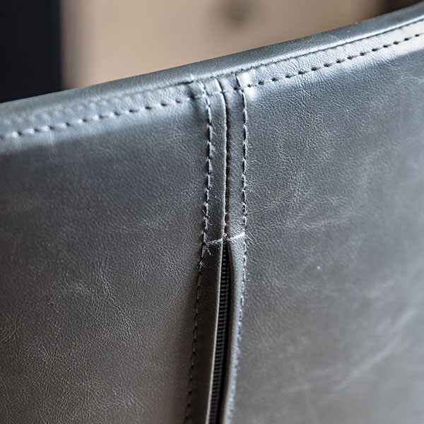 Gallery Direct Mendel Charcoal Swivel Chair - Close up image of part of the back of the chair