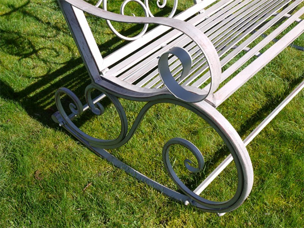 Antique Grey Metal Swirl Garden Rocking Bench - Close up image