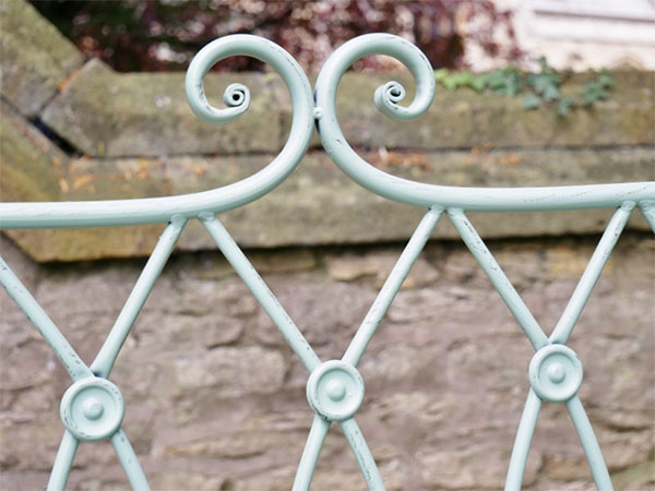 Pistachio Green Button Metal Garden Bench - Close up image of part of the back of the bench