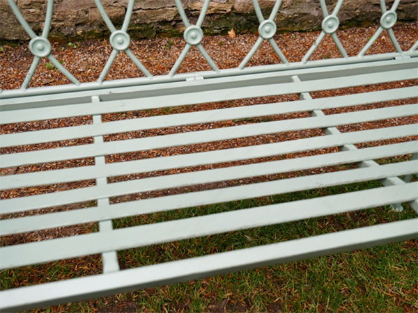 Pistachio Green Button Metal Garden Bench - Close up image showing the button design on the back of the bench