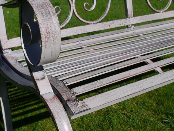 Antique Grey Metal Swirl Garden Bench - Close up image of the antique grey paint finish