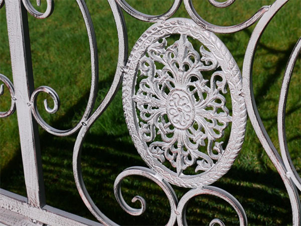 Antique Grey Metal Swirl Garden Bench - Close up image of the decorative pattern on the back of the garden bench