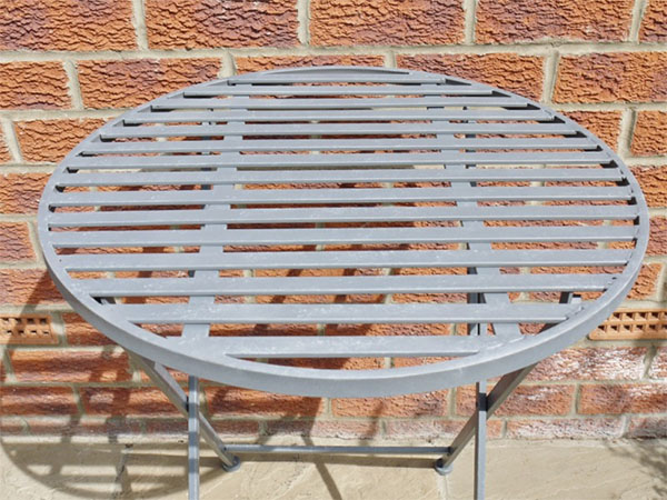 Industrial Grey Round Metal Garden Table - Close up of the top of the table