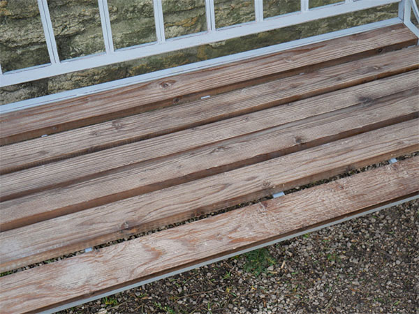 Antique Grey Iron / Fir Wood Garden Bench - Close up image showing the wood on the bench seat and part of the metal frame