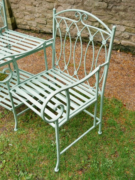 Pistachio Green Lovers Metal Garden Bench - Close up image showing one of the chairs and part of the central table on the Lovers bench