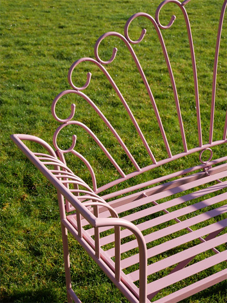 Pink Metal Garden Bench -Close up image showing the pink paint finish and the pattern on the pink metal garden bench