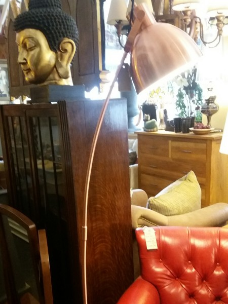 Shiny copper floor standing lamp on display in our Southport furniture showrooms