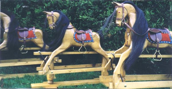 A Trio of Large Rocking Horses in Natural Polished Pine Finish