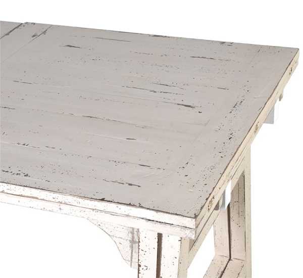 Close up image looking down onto to the top of the off-white distressed painted extending dining table