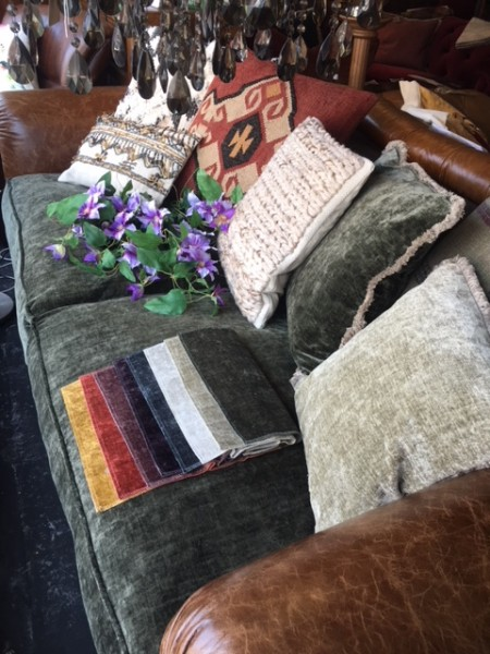 Tetrad Constable Midi Sofa on display with fabric swatches