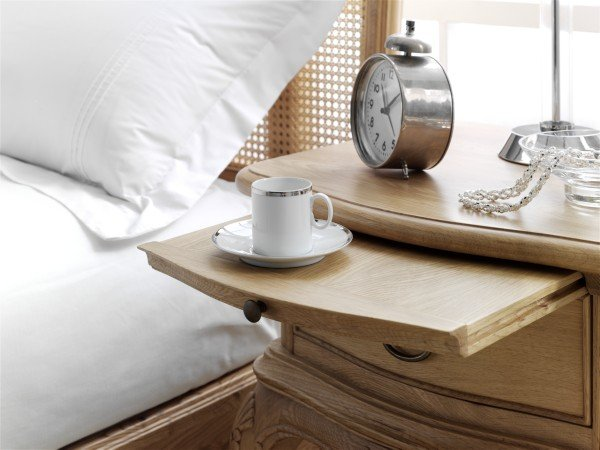 Close up image of part of the Willis and Gambier oak bedside table showing the pull out shelf