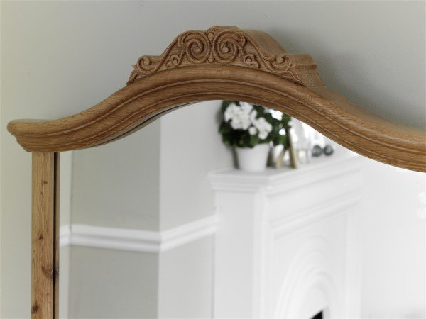 Close up image of the carved detailing on the Willis & Gambier Charlotte Mirror